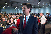 © Licensed to London News Pictures.01/03/2014. LONDON, UK. Ed Miliband leaves the hall as delegates vote on his reforms covering leadership elections, membership and links with the unions  The Labour Party Special conference today at Excel London on 1st March 2014.  Photo credit : Stephen Simpson/LNP