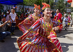 URUMQI, Sept. 12, 2016 (Xinhua) -- Residents of a community dance to celebrate the Corban Festival in Urumqi, capital of northwest China's Xinjiang Uygur Autonomous Region, Sept. 12, 2016. On Monday, Muslims in China welcomed Corban Festival, also known as Eid al-Adha or the feast of the sacrifice. (Xinhua/Wang Fei) (zhs) (Credit Image: © Wang Fei/Xinhua via ZUMA Wire)