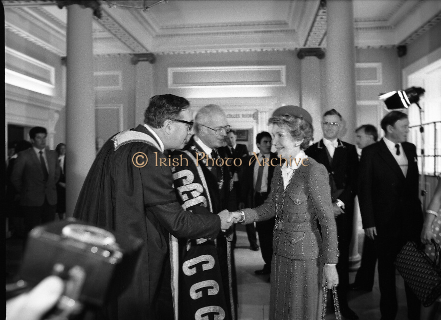 Nancy Reagan .Visits the Royal College Of Surgeons..St Stephens Green,.1984..04.06.1984.06.04.1984.4th June 1984..Nancy Reagan visited the Royal College of Surgeons where she unveilled a portrait of her late father.Her father, Dr Loyal Davis was an Honorary Fellow of the college. Mrs Reagan then presented the portrait to the college..Image of Mrs Nancy Reagan as she is wecomed to the Royal College Of Surgeons as she is welcomed by Professor Eoin O'Malley,president of the college,and other dignitaries.