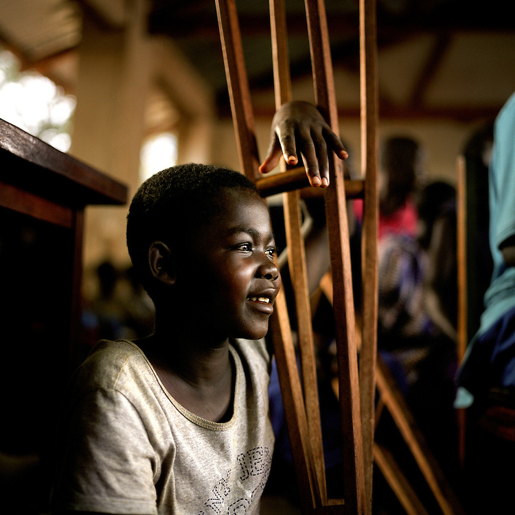 A girl abducted and injured in the war at sunday church service, Uganda. Children in Save the children supported Gusco rehabilitation centre in Gulu, North Uganda.
