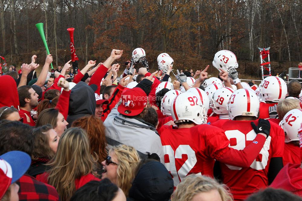 SJU celebrates the victory on the field. Credit: Brace Hemmelgarn-Saint John's University