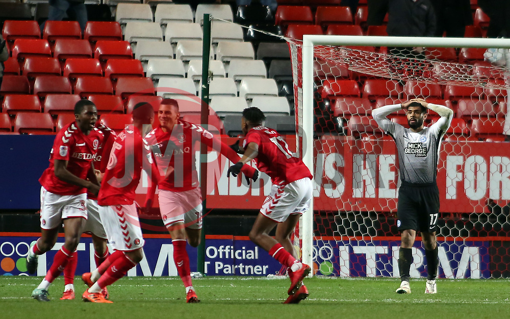 Alex Penny of Peterborough United cuts a dejected figure as Charlton Athletic celebrate scoring their equalising goal - Mandatory by-line: Joe Dent/JMP - 28/11/2017 - FOOTBALL - The Valley - Charlton, London, England - Charlton Athletic v Peterborough United - Sky Bet League One