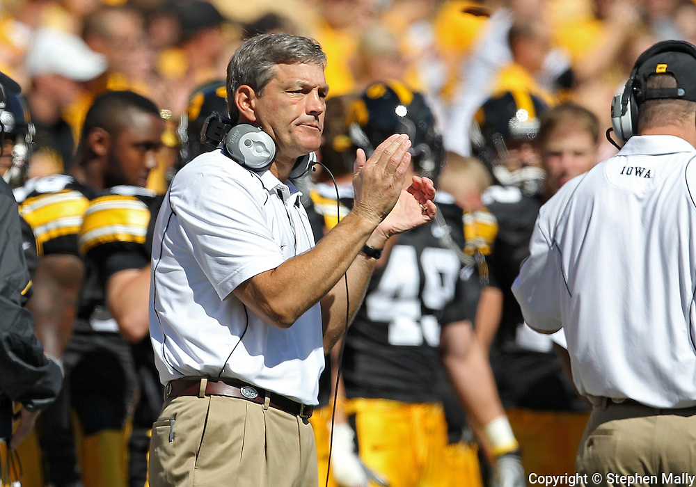 September 4 2010: Iowa Hawkeyes head coach Kirk Ferentz applauds his team during the first quarter of the NCAA football game between the Eastern Illinois Panthers and the Iowa Hawkeyes at Kinnick Stadium in Iowa City, Iowa on Saturday September 4, 2010. Iowa defeated Eastern Illinois 37-7.