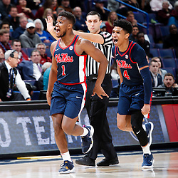 ST. LOUIS, Mo., -- Game 02 of the 2018 SEC Men's Basketball Tournament played between Ole Miss and South Carolina, Wednesday, March 07, 2018 at the Scott Trade Center in ST. LOUIS. Ole Miss guard Deandre Burnett, left, and guard Breein Tyree celebrate in the second half.