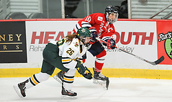PITTSBURGH, PA - OCTOBER 14:  Rikki Meilleur #10 of the Robert Morris Colonials passes the puck in front of Ève-Audrey Picard #26 of the Vermont Catamounts in the second period during the game at 84 Lumber Arena on October 14, 2016 in Pittsburgh, Pennsylvania. (Photo by Justin Berl)