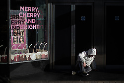 © Licensed to London News Pictures . 24/10/2018. Leeds , UK . A man sitting on the pavement inside a shop doorway on Briggate in Leeds City Centre . At least six people sleeping rough have died in the Metropolitan Borough of the City of Leeds since March 2017 and West Yorkshire Police say they responded to 66 reported cases of people suffering the effects of Spice in July 2018 , a large increase on previous months . Photo credit : Joel Goodman/LNP