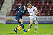 Aidan Fitzpatrick (#21) of Partick Thistle FC holds off Benjamin Garuccio (#17) of Heart of Midlothian during the William Hill Scottish Cup quarter final replay match between Heart of Midlothian and Partick Thistle at Tynecastle Stadium, Gorgie, Edinburgh Scotland on 12 March 2019.