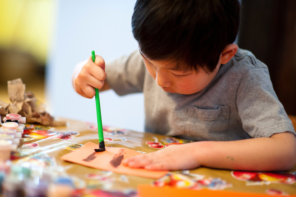 "Holden Miller, 4, continues his obsession with writing the letter ""H"" as he paints at the dining room table of the Miller/Stute home in Madison, Wis., on Feb. 12, 2012."