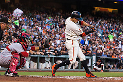 SAN FRANCISCO, CA - JULY 26: Ramiro Pena #1 of the San Francisco Giants hits an RBI single against the Cincinnati Reds during the second inning at AT&T Park on July 26, 2016 in San Francisco, California.  (Photo by Jason O. Watson/Getty Images) *** Local Caption *** Ramiro Pena