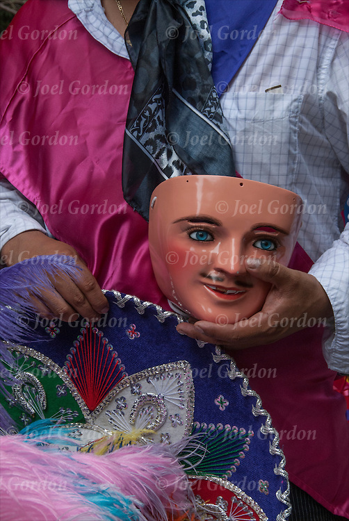 Close up Mexican American dressed in traditional carnival costumes holding his mask, shows his ethnic pride for Mexico during the Mexican Day Parade in New York City.