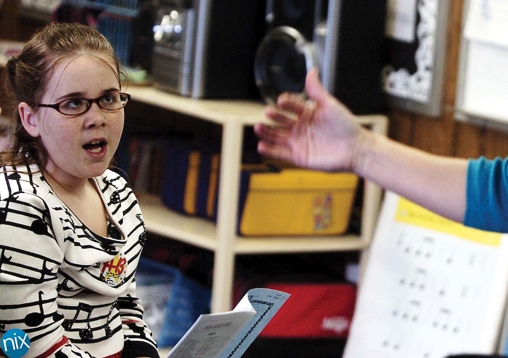 Fifth-grader Kadison Mills sings as her teacher Laura Cook conducts during chorus practice at Wolf Meadow Elementary School Thursday afternoon. Mills dreams of being a singer and will try out for the reality show America's Got Talent.