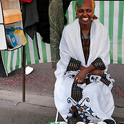 Hackney, London, England. Ridley Road market. Negist and her Ethiopian food stall.