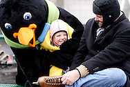 Parker the Penquin borrows a blanket from Marsha Fye of Brookville to surprise Liz, 8 (center) and Dennis Stone of Kettering during a session with the ice rink's mascot at the RiverScape MetroPark in downtown Dayton, Sunday, January 22, 2012.