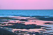 Shoreline along the Gulf of St. Lawrence at sunrise<br />Sainte-Flavie<br />Quebec<br />Canada