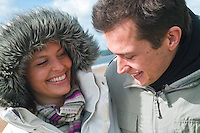 Young couple (man and woman) on seafront in Winter clothing<br /> Swansea<br /> Autumn and Winter<br /> South<br /> Lifestyle