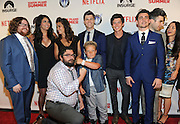 The cast of Staten Island Summer, Zack Pearlman, Cecily Strong, Gina Gershon, Colin Jost, Graham Phillips, John DeLuca, Casey Jost, Katie Cockrell, back row left to right, and Bobby Moynihan and Jackson Nicoll, front row left to right, celebrate the premiere of the movie Staten Island Summer at Sunshine Cinema, Tuesday, July 21, 2015, in New York.  The new comedy debuts on Netflix on July 30, 2015 and is available for Digital download. (Photo by Diane Bondareff/Invision for Paramount Pictures/AP Images)