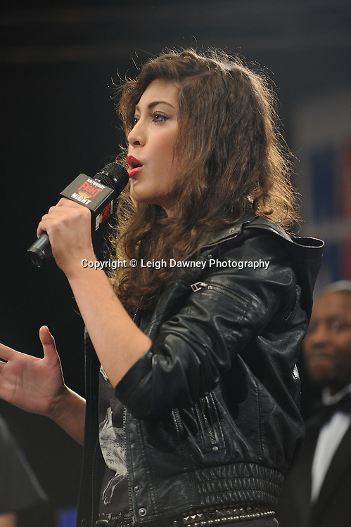 SInger sings both countries national anthems before Jamie McDonnell defeats Stephane Jamoye on the 22nd January 2011 at Doncaster Dome, Doncaster - Frank Maloney Promotions. Credit © Leigh Dawney.