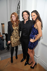 Left to right, PRINCESS BEATRICE OF YORK, STEPHEN WEBSTER and GEORGINA CHAPMAN at a party to launch the Georgina Chapman collection for Garrard held at Garrard, Albermarle Street, London on 4th November 2009.