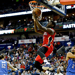 Dec 21, 2016; New Orleans, LA, USA;  New Orleans Pelicans guard Jrue Holiday (11) shoots over Oklahoma City Thunder forward Andre Roberson (21) during the second half of a game at the Smoothie King Center. The Thunder defeated the Pelicans 121-110. Mandatory Credit: Derick E. Hingle-USA TODAY Sports