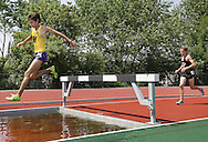 Warwick's Aaron Peterson leads Dover's Matthew Lee in the 3000-meter steeplechase at the Section 9 track and field state qualifier in Middletown on Friday, May 31, 2013. Peterson won the race and qualilfied for the state meet next Friday and Saturday in Middletown.
