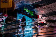New York - Times square . reflection of the advertising bilboards  in water /   reflets dans des flaques d'eau à Times square