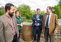 Pictured: Josiah Lockhart, Maia Gordon, Keith Brown and George Elliis<br /> <br /> Cabinet Secretary for Economy, Jobs & Fair Work Keith Brown visited Gorgie City Farm today  to mark their accreditation as the 800th Living Wage employer in Scotland. Mr Brown met Josiah Lockhart, CEO and undertook a short tour of the farm, celebrating their accreditation and promoting the Living Wage more generally. The Scottish Government has set a target of reaching 1,000 Scottish-based Living Wage Accredited Employers by autumn 2017. While at the farm Mr Brown met Maia Gordon, Kirsty McGoff (17) and Zoe White (18), who have benefited from the living wage, and George Ellis, chair of the farm's board of directors<br /> Ger Harley | EEm 18 May 2017