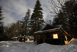 Cabins by moonlight at the AMC's Little Lyford Pond Camps in Maine's Northern Forest.  Near Greenville.