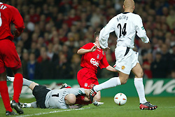 CARDIFF, WALES - Sunday, March 2, 2003: Liverpool's Michael Owen is brought down by Manchester United's goalkeeper Fabien Barthez during the Football League Cup Final at the Millennium Stadium. (Pic by David Rawcliffe/Propaganda)