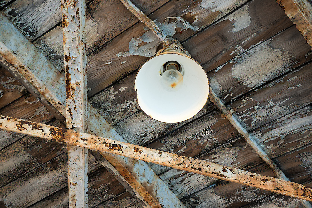 Warehouse ceiling light and rusted beams at Winehaven, a dilapidated former California winery and Naval fuel depot at Point Molate in Richmond, California.