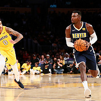 02 October 2017: Denver Nuggets forward Paul Millsap (4) drives past Los Angeles Lakers forward Kyle Kuzma (0) during the Denver Nuggets 113-107 victory over the LA Lakers, at the Staples Center, Los Angeles, California, USA.
