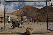 Potosi, Bolivia.<br /> Sunday in Potosi miners spend the afternoon playing football beneath the Cerro Rico mountain.