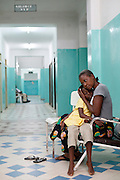 A mother waits with her daughter before she is called for surgery. Operation Smile South Africa.Clinique Ngaliema, Avenue Des Cliniques.KInshasa, DRC.
