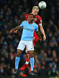Raheem Sterling of Manchester City challenges for a header with Hordur Magnusson of Bristol City - Mandatory by-line: Matt McNulty/JMP - 09/01/2018 - FOOTBALL - Etihad Stadium - Manchester, England - Manchester City v Bristol City - Carabao Cup Semi-Final First Leg