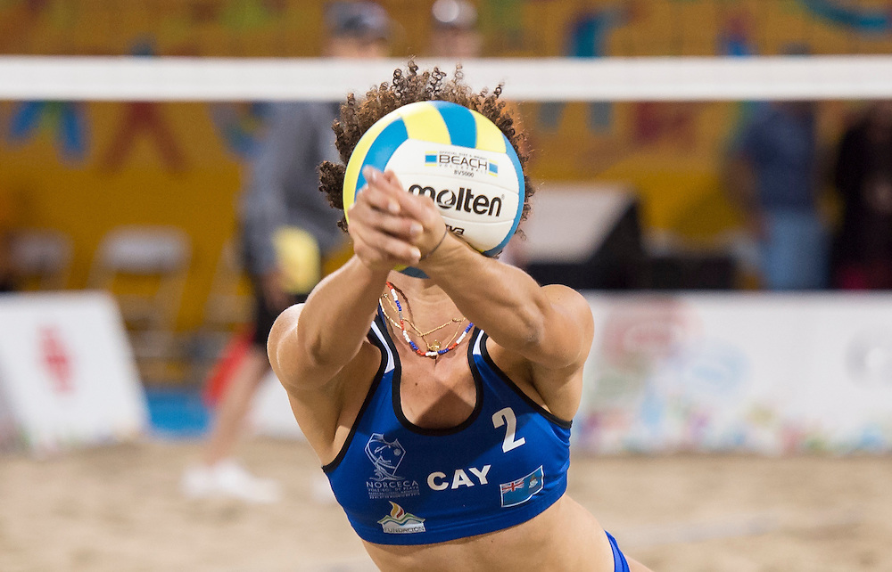Llean Powery of the Cayman Isalnds during the the preliminary rounds of beach volleyball competition at the 2015 PanAm Games in Toronto.