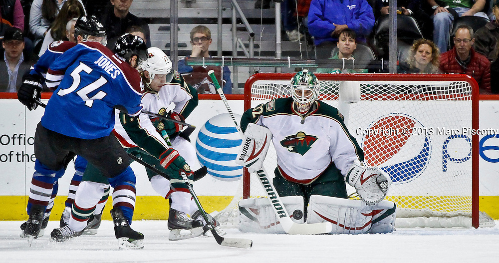 SHOT 3/16/13 1:24:31 PM - The Minnesota Wild's Niklas Backstrom #32 stops a shot by the Colorado Avalanche's David Jones #54 during their regular season NHL game at the Pepsi Center in Denver, Co. The Minnesota Wild won the game 6-4. (Photo by Marc Piscotty / © 2013)
