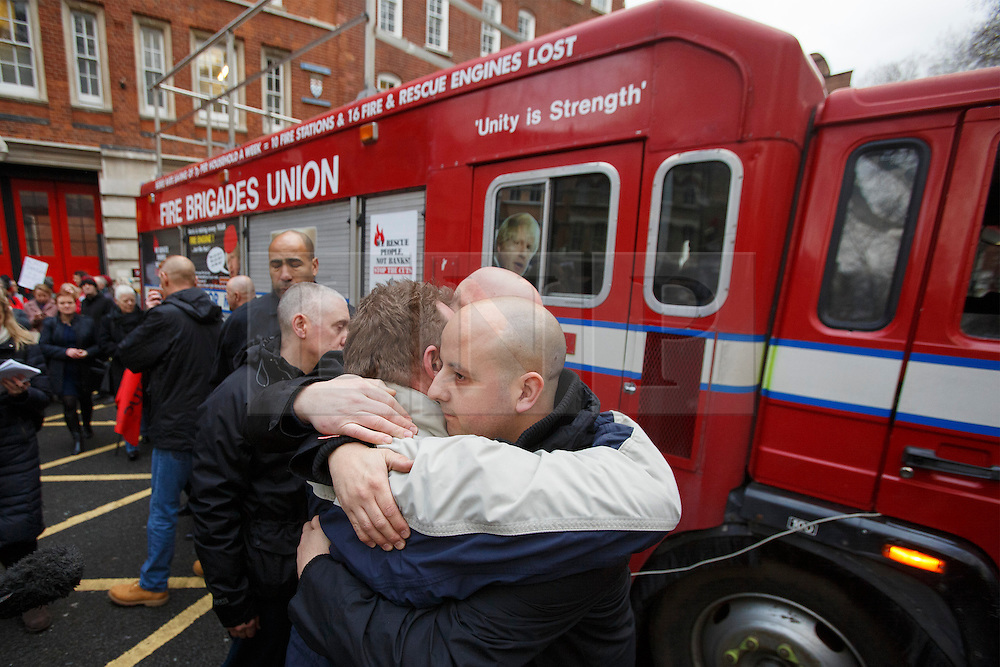 © licensed to London News Pictures. London, UK 09/01/2014. Firefighters of Clerkenwell Fire Station finishing their last shift at the station which is being closed with 9 more fire stations in London on Thursday, 09 January 2014 by London Fire Brigade (LFB) to save £28.8m. Photo credit: Tolga Akmen/LNP