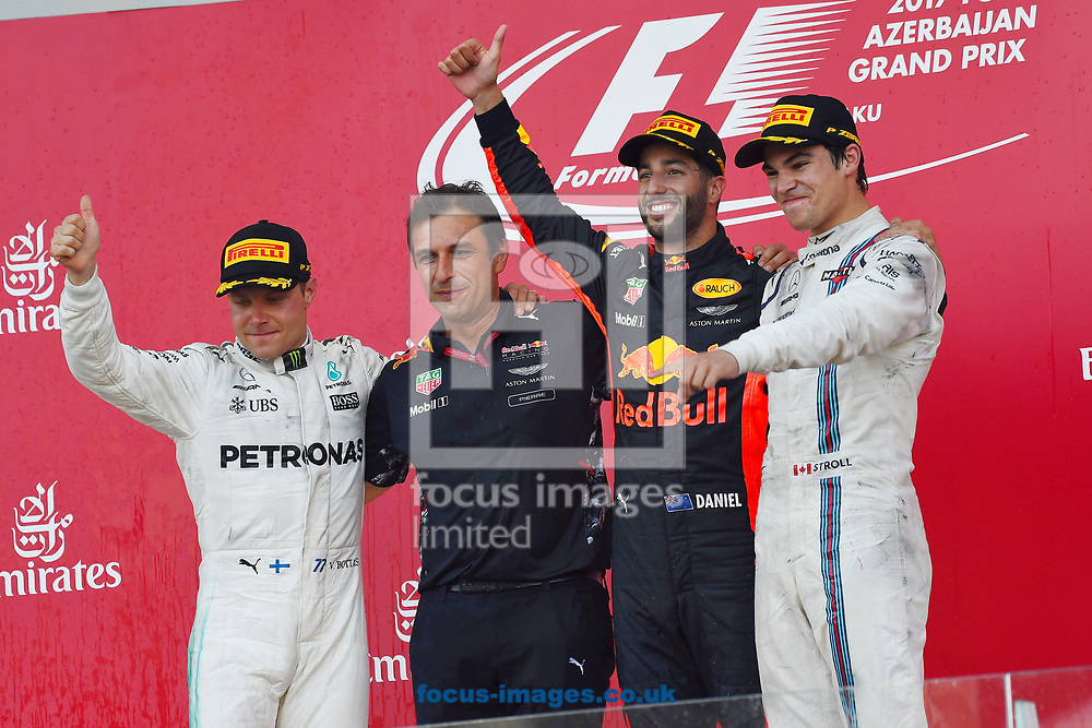 Valtteri Bottas of Mercedes AMG Petronas, Daniel Ricciardo of Red Bull and Lance Stroll of Williams Martin on the podium of the Azerbaijan Formula One Grand Prix at Baku City Circuit, Baku<br /> Picture by EXPA Pictures/Focus Images Ltd 07814482222<br /> 25/06/2017<br /> *** UK & IRELAND ONLY ***<br /> <br /> EXPA-EIB-170625-0063.jpg