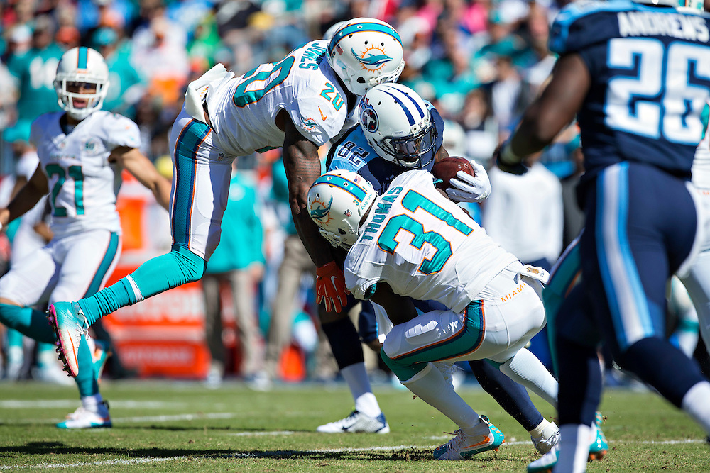 NASHVILLE, TN - OCTOBER 18:  Delanie Walker #82 of the Tennessee Titans is tackled by Reshad Jones #20 and Michael Thomas #31 of the Miami Dolphins at LP Field on October 18, 2015 in Nashville, Tennessee.  The Dolphins defeated the Titans 38-10.  (Photo by Wesley Hitt/Getty Images) *** Local Caption *** Delanie Walker; Reshad Jones; Michael Thomas