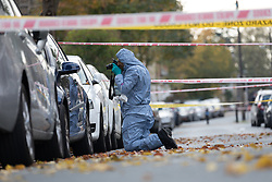 © Licensed to London News Pictures. 03/11/2017. LONDON, UK.  Police cordon and forensic officer on Walpole Road, Walthamstow where a fast food delivery driver was the victim of an attack where a corrosive substance, believed to be acid was thrown in his face.  Photo credit: Vickie Flores/LNP