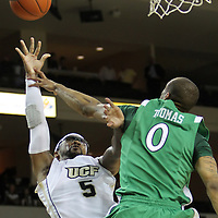 Marshall forward Johnny Thomas (0) fouls Central Florida guard Marcus Jordan (5) during a Conference USA NCAA basketball game between the Marshall Thundering Herd and the Central Florida Knights at the UCF Arena on January 5, 2011 in Orlando, Florida. Central Florida won the game 65-58 and extended their record to 14-0.  (AP Photo/Alex Menendez)
