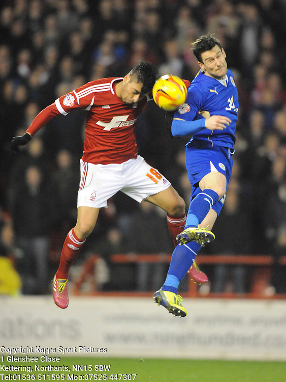 Forests Gonzalo Jara, Beats Leicesters David Nugent to the Ball, Nottingham Forest v Leicester City, City Ground Nottingham,  Sky Bet Championship, 19th Febuary 2014