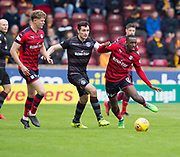28th April 2018, Fir Park, Motherwell, Scotland; Scottish Premier League football, Motherwell versus Dundee; Glen Kamara of Dundee takes on Carl McHugh of Motherwell as Mark O'Hara watches