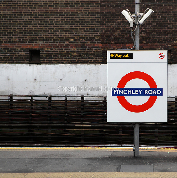Platform, sign, railway track and brick wall, FINCHLEY ROAD tube station, 1879, Jubilee Line, London, UK. Picture by Manuel Cohen