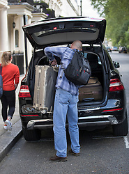 © Licensed to London News Pictures. 24/05/2016. London, UK. A member of Jose Mourinho's staff loads a suitcase into a car outside his London home. Mourinho is expected to be named as Manchester United manager in the next few days. Photo credit: Peter Macdiarmid/LNP