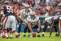 06 October 2013: Center (60) Brian De La Ponce of the New Orleans Saints gets ready to hike the ball to quarterback (9) Drew Brees against the Chicago Bears during the first half of the Saints 26-18 victory over the Bears in an NFL Game at Soldier Field in Chicago, IL.