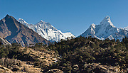 "Mount Everest (upper left; 29,035 feet / 8850 meters elevation, based on a 1999 GPS measurement), the highest mountain on Earth, was first called Chomolungma or Qomolangma (""Goddess Mother of the Earth"" in Tibetan). In 1865, Andrew Waugh, the British surveyor-general of India named the mountain for his chief and predecessor, Colonel Sir George Everest. In the 1960s, the Government of Nepal named the mountain Sagarmatha, meaning ""Goddess of the Sky"". The mountain, which is part of the Himalaya range in High Asia, is located on the border between Nepal and Tibet, China. On the right is Ama Dablam. Sagarmatha National Park was created in 1976 and honored as a UNESCO World Heritage Site in 1979."