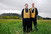 Gyokuko Carlson, left, an abbot with the Dharma Rain Zen Center, and Kakumyo Lowe-Charde, the organization's development director, stand on former landfill site in Northeast Portland on which the Zen Center is hoping to build a new facility.
