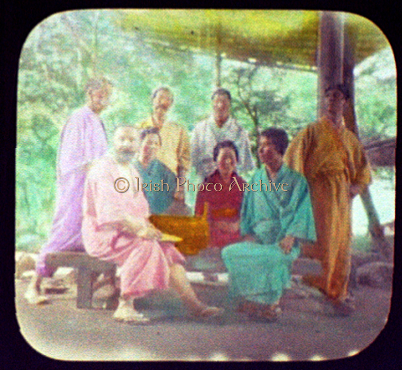 Members of the World Trade Commision dressed in kimonos at the Miyajima Inn, Miyajima, Japan.  Hand-coloured magic lantern slide, 1895.