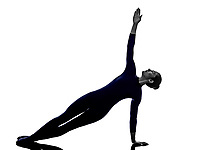 woman exercising Vasisthasana side plank pose yoga silhouette shadow white background