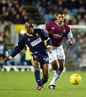 Photograph: Scott Heavey.<br />Wimbledon v West Ham United. Nationwide Division One. 15/11/2003.<br />Mikele Leigertwood battles with Hayden Mullins (R)